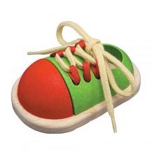 Oefen schoen voor veter strikken